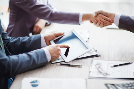 Business people pointing at ipad